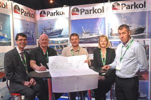 Leonard Anderson of LCL Shipping (second left) signs the contract for Parkol to build a 27m salmon feed carrier, watched by Ian Paton, James Morrison, Sally Atkinson and Andrew Oliver.