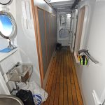 Heated lockers line the hull side in the port passageway, which gives access to the deck house and connects the catch-handling area with the trawl deck aft.