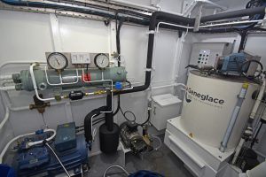 Fishroom refrigeration plant, and a 2.5t Geneglace ice machine, are housed in a walk-in room inboard of the catch reception hopper.