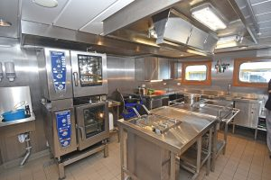 Meals for a crew of 32 are prepared in the stainless-steel galley…