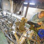 Luke checking the oil levels of Valentine's Gardner 6LXB engine.