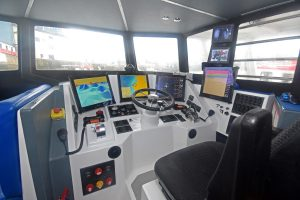 The central steering console in Onward's wheelhouse.