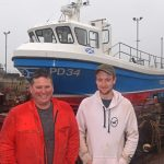 Arbroath skipper Tommy Yule and his son Tommy prepare to take Onward S off Peterhead slipway, before starting to fish from Arbroath.