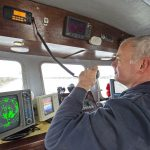 Paul checking boat-to-boat communications on channel 6.