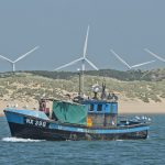 The inshore netter Nicole B returning home to Rye, with the Little Cheyne Court wind farm in the distance.