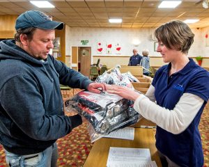 Seafish's regional manager for Wales Holly Whiteley distributing PFDs.