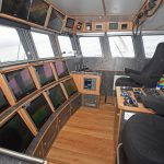 The wheelhouse is arranged to give easy access between the port and starboard fishing consoles.