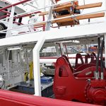 10t Gilson winches are positioned atop the shelterdeck directly above the pulling-down winches mounted on the legs of the lifting gantry, aft of the 20t split trawl winches located forward on the main deck.