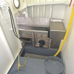 … deliver the contents of the scallop dredges to enclosed selection areas forward.