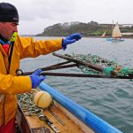 Chris Vinnicombe shoots a dredge overboard at the start of a drift.