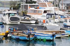 Two smaller oyster punts tied up at Mylor harbour.