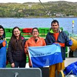 Faron McLellan and Helena Delgado Nordmann onboard the longliner Inverdale INS 29, with crew holding their new Fishing For Litter flag.