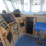 The starboard engineroom is accessed via a door in the side of the wheelhouse.
