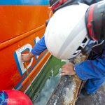 Measuring a mark on the side of the hull above the waterline...