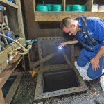 Charles Blyth checking fuel tanks for contamination.