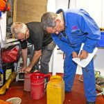 Roger Gee and owner Sean Irvine checking the vessel's flares, PFDs, first aid packs…