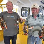 Two generations of Frenchs – Johnny and Andrew – and four lobsters.