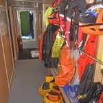 An extensive selection of protective clothing is ready for use in the port passageway…