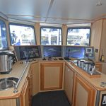 The fishing console is arranged in the starboard aft corner of the wheelhouse.