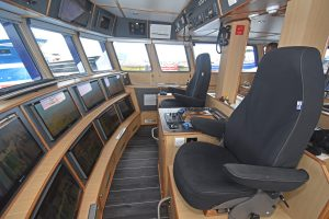 Two NorSap skipper's seats flank a central console.