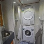 Clothes-washing and drying facilities are built into the shower room.