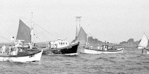 Larry's shot of hand-line boats, midway through the mackerel boom, when he was aboard the Kim-Bill. Boy Anthony PZ 518 is far left, and the black boat is Boy Gary PZ 576. Larry took this picture at first light, by pushing the speed of the black and white film and spending hours in his darkroom to get the best from a near-impossible task.