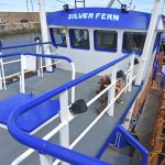 Open side decks lie to port and starboard of a central shelterdeck walkway.