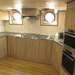 … and messdeck, with enlarged portholes and twin tables.