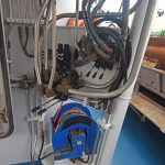 Pulling-down winches are positioned on ledges under the localised controls near the heel of the lifting gantry amidships.