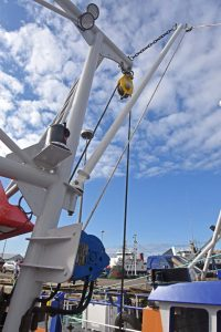 Auxiliary tipping winches and short derricks are fitted towards the top of the Scotch poles.