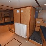 Four bunks are arranged in the aft cabin, either side of the compartment housing the Wills Ridley steering gear.