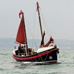 The superbly restored sailing lifeboat Henry Frederick Swan heads out across South Bay.