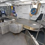 Pot-clearing, rebaiting and crab-cutting activities are arranged across the fore end of the working deck.