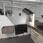 A second shooting table and hatch are arranged at the transom…
