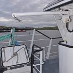 A small derrick arm and winch mounted on the aft side of the wheelhouse are used to lift creels to and from the main deck through a hatch in the shelterdeck.