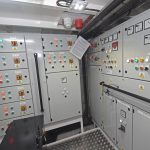 The electrical distribution cabinets extend aft on the port side of the forward engineroom.