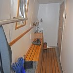 Heated oilskin and hot drink facilities are arranged along the starboard side of the hull on the main deck.