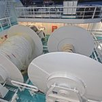 Two underspooled net drums are arranged at boat deck level.