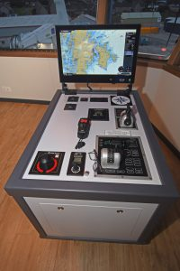 Vessel manoeuvring consoles are located on either side of the wheelhouse.