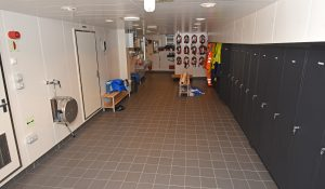The wet gear crew changing room is arranged along the port side of the hull...