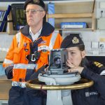 Operations officer Lt Emily Witcher navigating HMS Tyne through the deepwater channel, with the pilot overseeing the operation.
