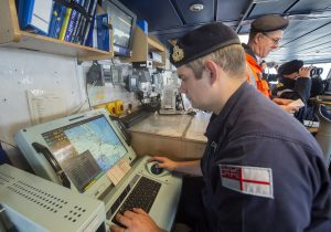 Correspondence officer Lt Joseph Darwell assisting the ship's departure using the warship electronic chart display information system (WECDIS).