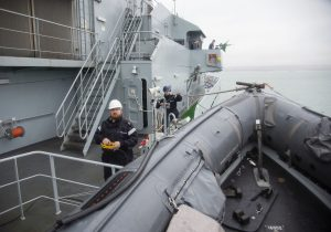 LS (Sea) Carl Amas lowering the Pacific 24 RIB from HMS Tyne.