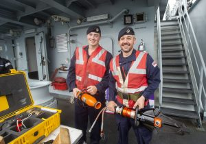 LET (ME) Richard Church and ET (ME) Matthew Wiltshire checking the ship's firefighting systems and 'jaws of life', which are used in damage control.