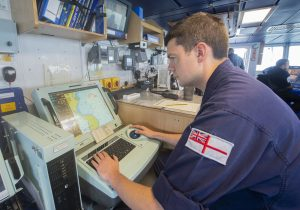 Warfare officer under training SLt Nick Ingledew planning the course back to HMNB Portsmouth.