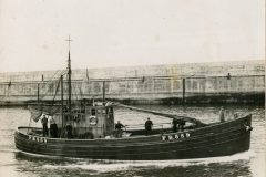 Jessie West leaving Fraserburgh at the start of a herring drift-net trip… (Photo: John Addison)