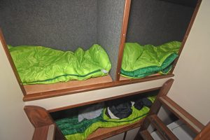 … is arranged forward of three bunks positioned under the wheelhouse floor.