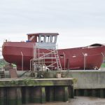 The rebuilt boat was given a coat of primer…