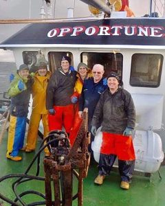 Opportune's crew on the shelterdeck while towing their last haul. Left to right: Michael Munro, Alistair Jappy, David Mackay, Magnus Cowie, skipper David Fraser and Keith Macadle.
