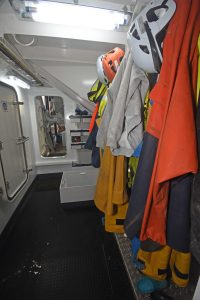 The fore and aft passageway is situated between the deck casing to starboard and the port side catch hopper.